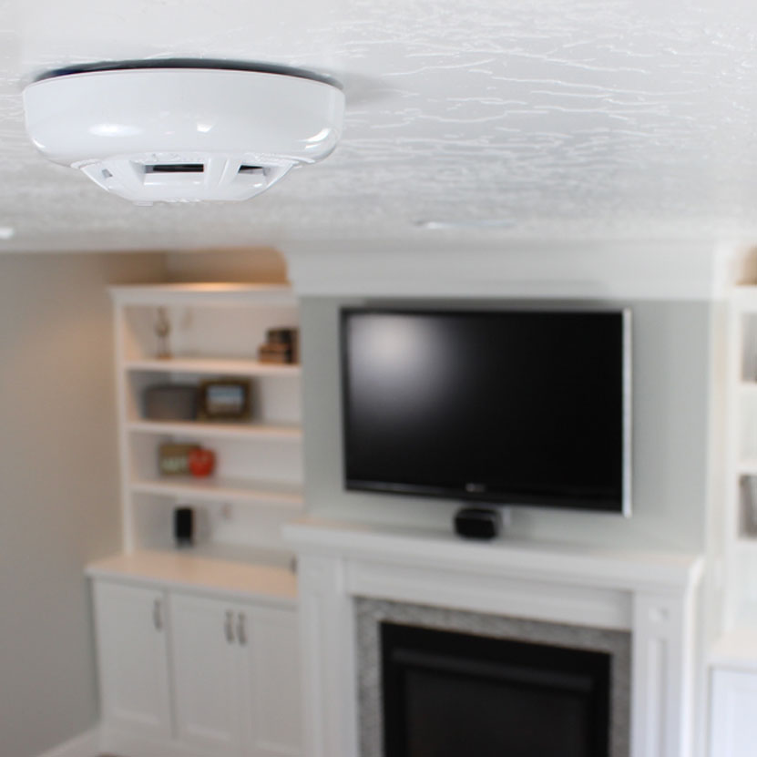 Qolsys IQ Carbon Detector on top of ceiling