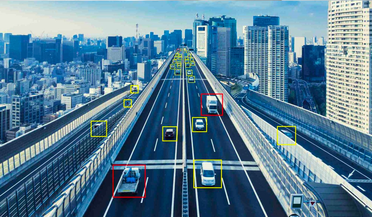 City view of highway with cars being monitored with green and red boxes around them