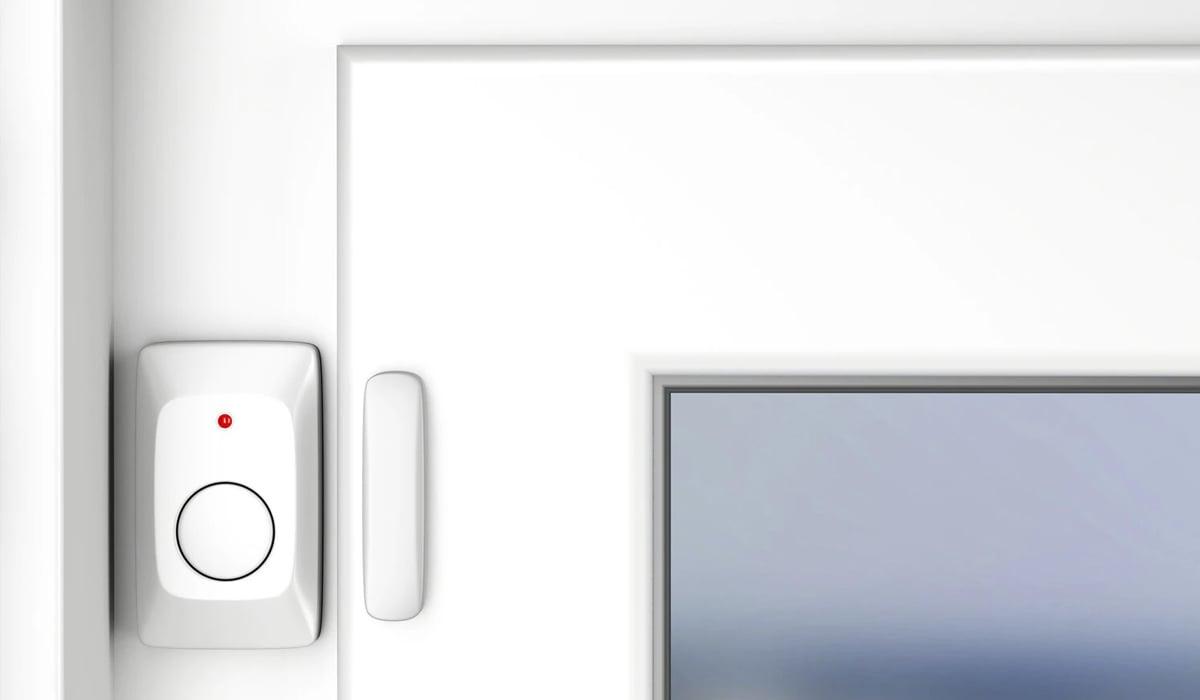 Close up on door with security sensor
