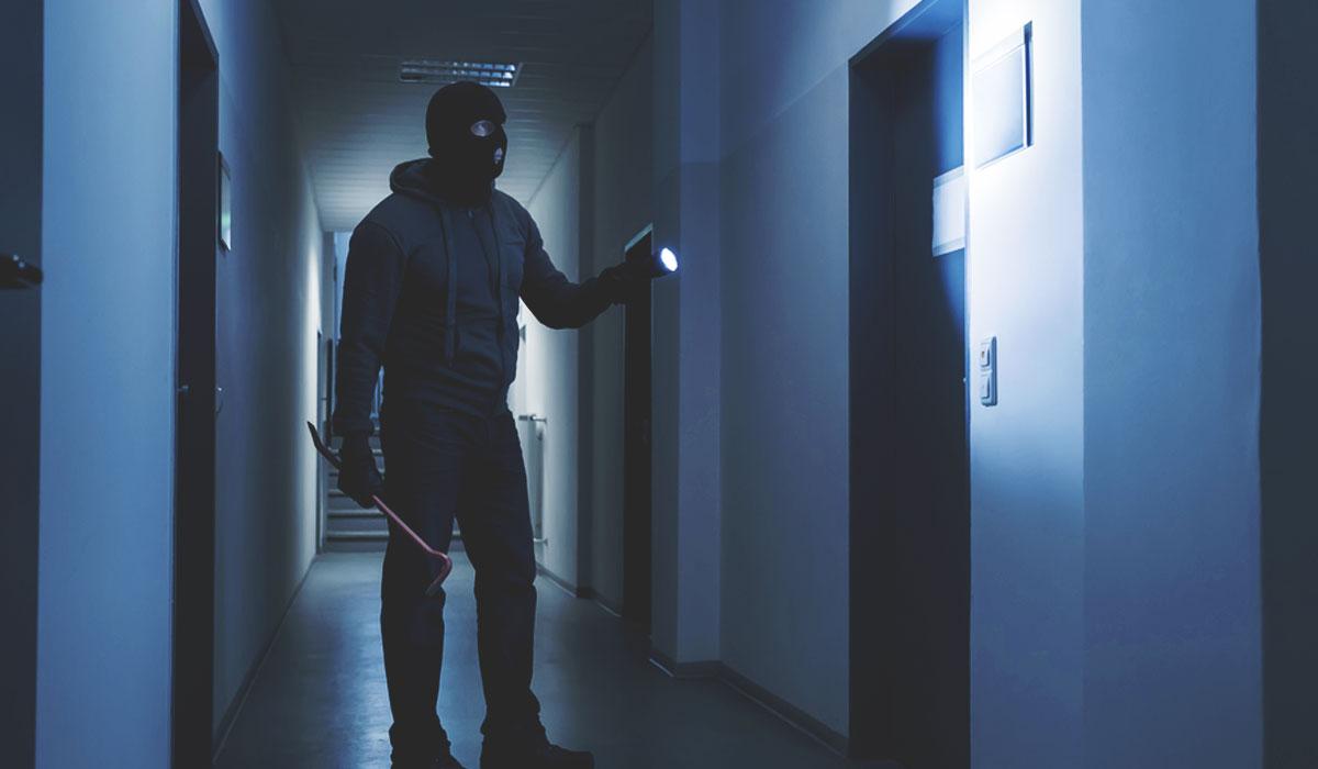 Burglar in office building