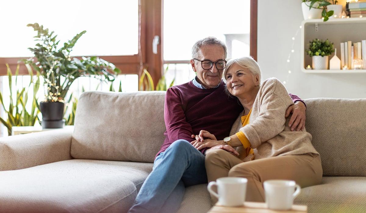 Senior Couple sitting enjoying time together on couch