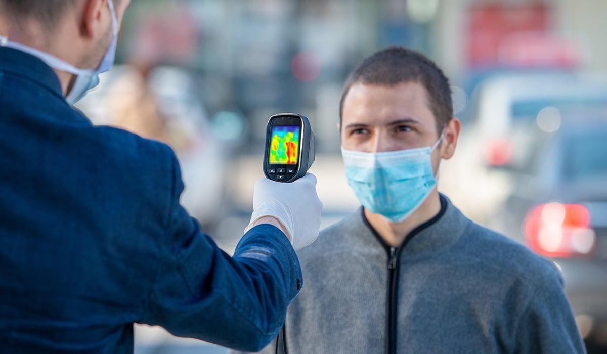 Thermal Imaging Camera pointing at sick individual
