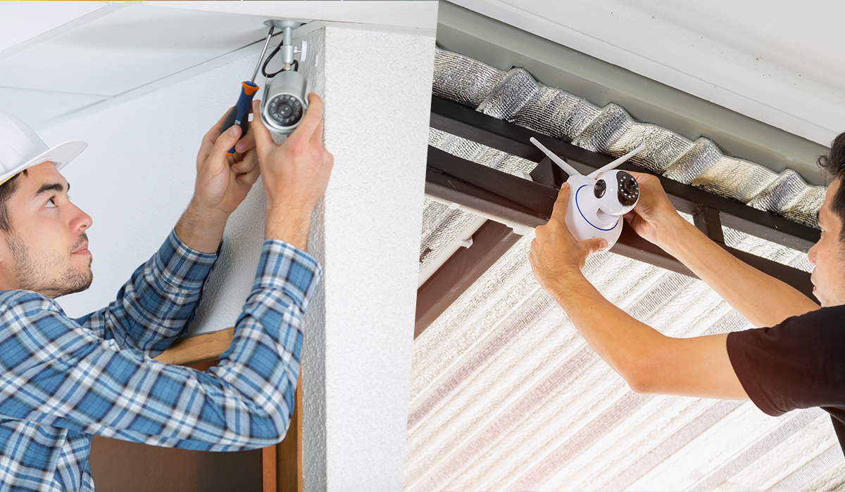 Man installing wireless camera next to man installing wired camera