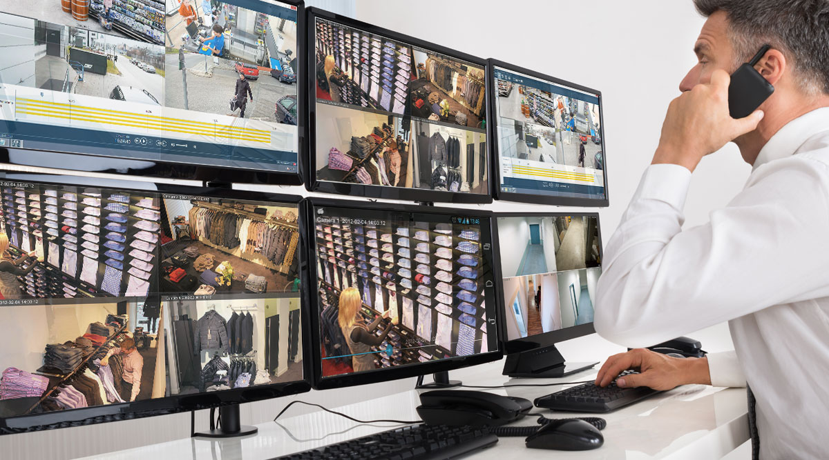 man monitoring video systems