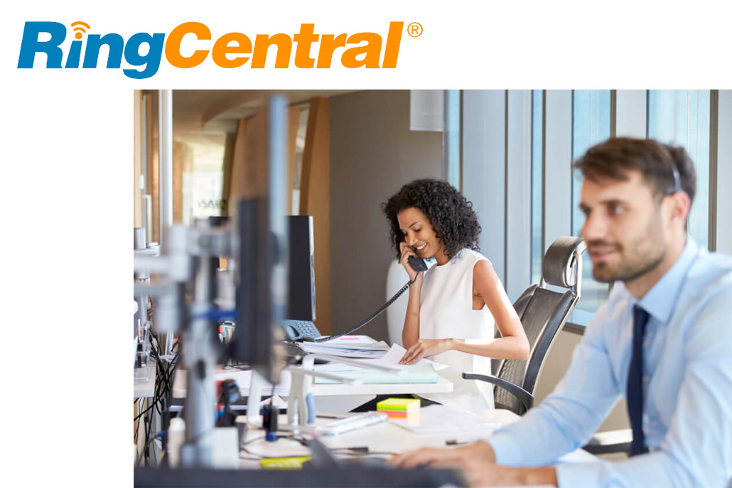 man and woman in office environment working at desks