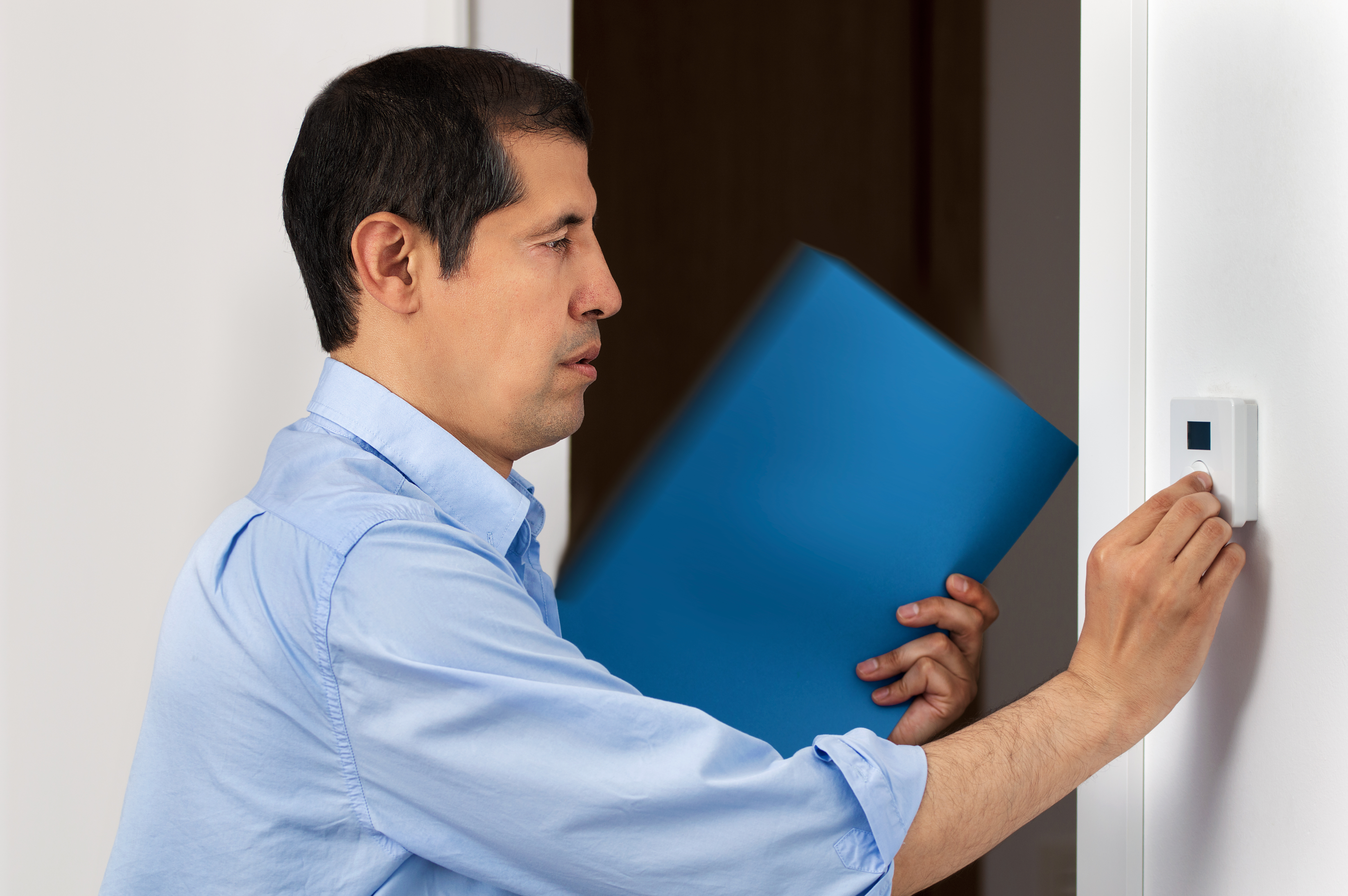 Man entering code into security system module